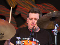 Doug Belote on drums