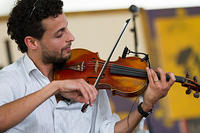 Eric Rodriguez on violin
