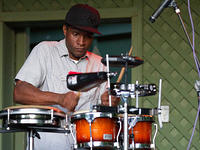 Dwayne Muhammad on percussion